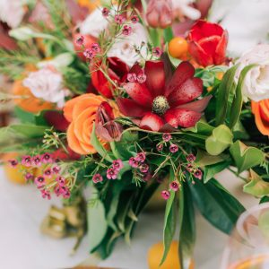 pretty table flower arrangement with fruit