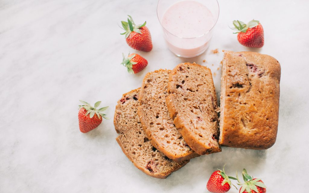 strawberry-bread-on-white-marble-with-strawberries-and-strawberry-milk